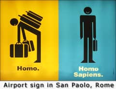 Sign in San Paolo, Rome — For those who don't understand this (it's Latin), 'Homo' means 'man'; 'Homo Sapiens' means 'wise man'.